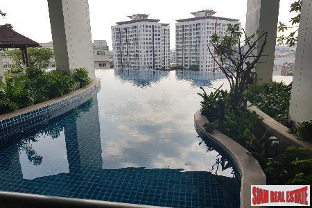 Sky Walk Condo | City Views from this One Bedroom + Study Room in Phra Khanong
