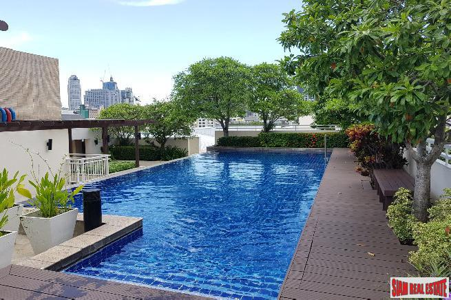 Pool and Garden Views from this Three Bedroom Condo for Sale Sukhumvit 49