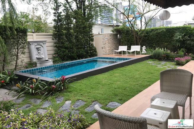 Exceptional Three Bedroom, Two Story House with Lush Garden and Private Pool at Sukhumvit 63
