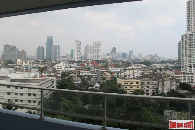 Stunning Three-Bedroom Riverside Condominium in Bangkok