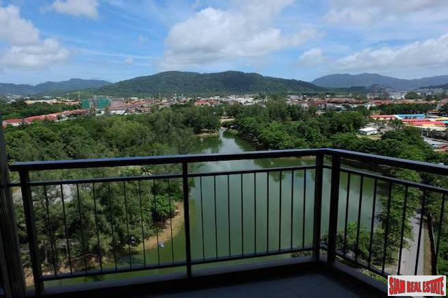 Elegant Two-Bedroom  Corner Condo in Phuket Town Overlooking A Lake and  Natural Park