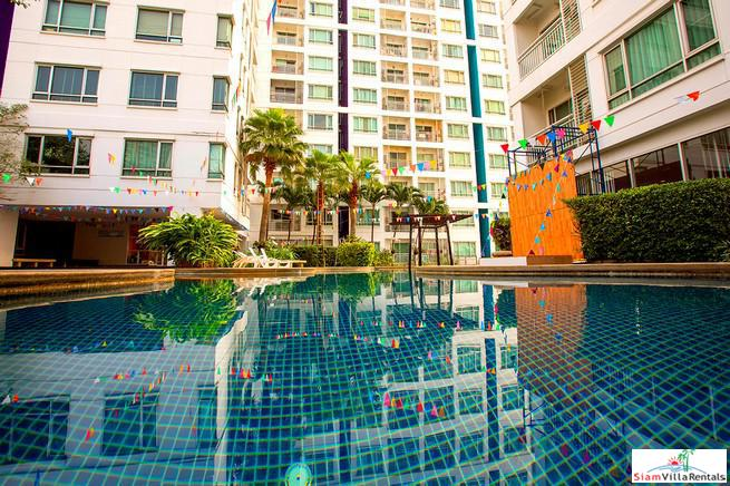 Sukhumvit Plus | Two Bedroom, Two Bath Condo with Wood Paneling and Floors near BTS Phra Khanong
