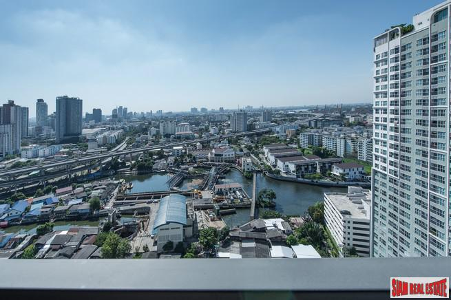 Bright and Cheerful Two Bedroom Condo with Amazing City Views in Phra Khanong