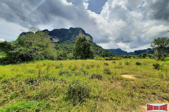 Over Four Rai of Flat Land and Beautiful Mountain Views for Sale in Khao Thong, Krabi