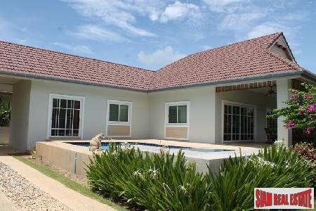 An affordable pool villa in a small development for sale.